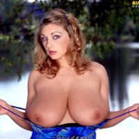 Solo model Autumn Jade sets her excellent titties loose while at the lake