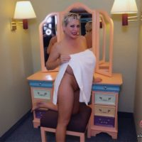 Solo model Claudia Marie shows her monster-sized titties while on a bed and in a tub