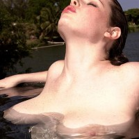 Solo model Desirae plays with her huge boobs while spending time in the water