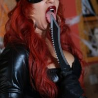 Solo model Karen Fisher frees her monster-sized tits and bum from spandex garment at Halloween