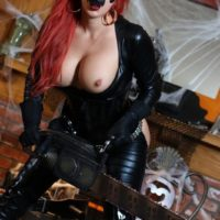 Solo model Karen Fisher bares her large boobs and ass from spandex clothing at Halloween