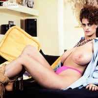 Solo model Nilli Willis holds her big fun bags after uncovering her hairy vagina