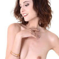 Solo model Sade Mare tucks a gigantic screw stick into her hairless cooch after stripping nude