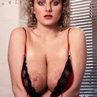 Solo model Suzanne Brecht reveals her boobs and ass from tempting lingerie in bathroom