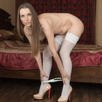 Stocking and high heel garmented brunette amateur parting wooly slit