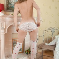 Stocking and lingerie clad Euro first timer uncovering wooly fuckbox