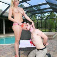 Tall blonde mistress Vanessa Cage has her subby hubby snuffle her honeypot and bootie in stilettos