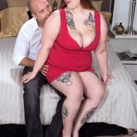 Tatted BBW Big-boobed Emma pulling out humungous boobs and tush before providing handjob