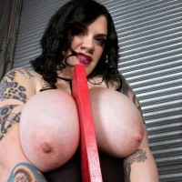 Inked BIG SEXY LADY Marilyn Mayson displaying monster-sized boobs and gigantic rump in black boots