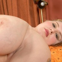 Tattooed BIG HOT WOMAN Miss Isabelle removes her satin lingerie and underwear in solo act