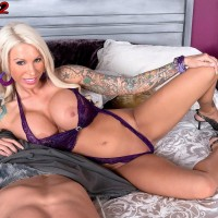 Inked blond MILF adult vid starlet Lolly Ink uncovering round melons for nip sucking