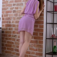 Teener first-timer Tina reveals her upskirt panties after showing her smallish breasts by herself
