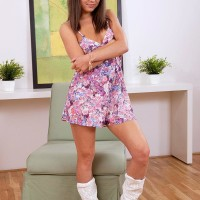 Teen cutie Spectacular Di unveiling little funbags and nipples in cowgirl boots and panties