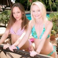 Teenager lezzies Sammy Daniels and Aubrey Star peel off each others bikini outdoors