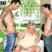 Chunky Sixty plus ash-blonde Mia Magnusson entices the gardeners outdoors for MMF sex