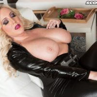 Thick blond model Holly Prick letting immense all-natural juggs free from leather outfit