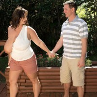 Plumper brown-haired female Maria Moore having immense juggs revealed outdoors