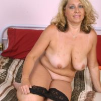 Chubber experienced blond lady stripping off lingerie and panties before masturbating