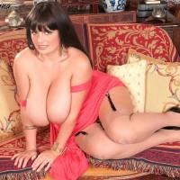 Chunky solo model Arianna Sinn lets her immense titties free from a dress in tan tights