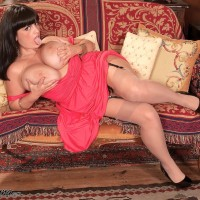 Chubber solo model Arianna Sinn lets her monster-sized tits loose from a sundress in tan nylons
