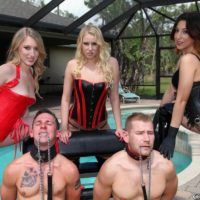 Three Dominatrixes in fetish garment manhandle two collared male subs on the pool patio