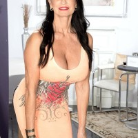 Top older X-rated actress Rita Daniels uncovers her gigantic titties and shows her underwear as well