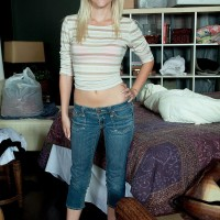 Youthful blond amateur Stacy Kiss doffing denim jeans and pink brassiere and panty set