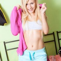 Youthful yellow-haired amateur Vanessa Staylon flashing uber-cute ass after taking off shorts
