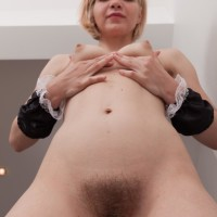 Youthfull Euro light-haired Baibira extracting hairy cooch from maid uniform in high heels