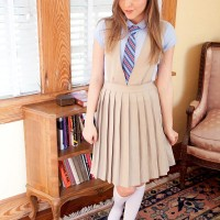 Young hottie Aubrey Star disrobing off college girl uniform to pose nude for first time